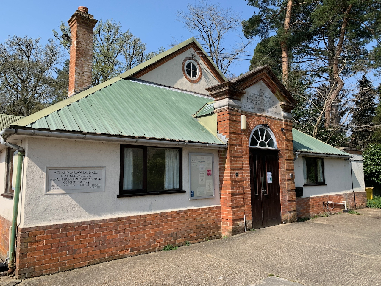 Acland Memorial Hall - a large brick built building with a metal roof.