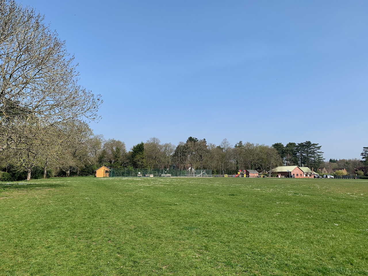 The big grass recreation ground with the tennis courts in the far distance.