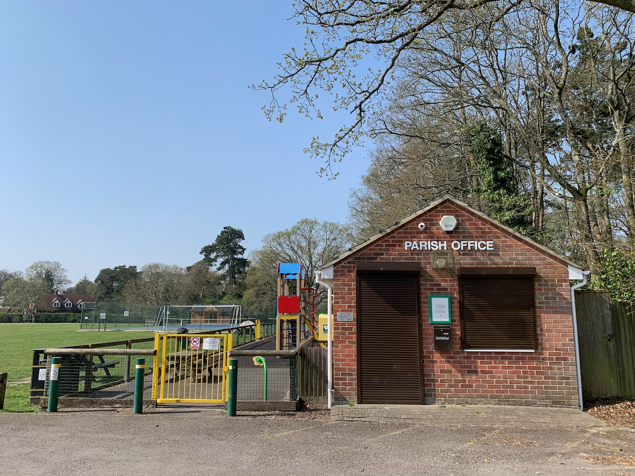 The brick built Parish Office is shown next to the children's play area.