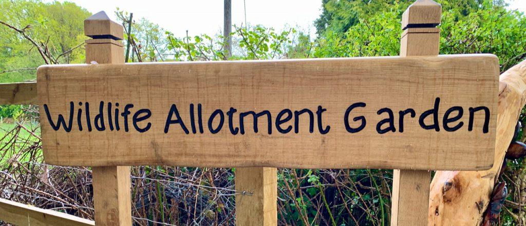 "Wooden sign saying ""Wildlife Allotment Garden"""