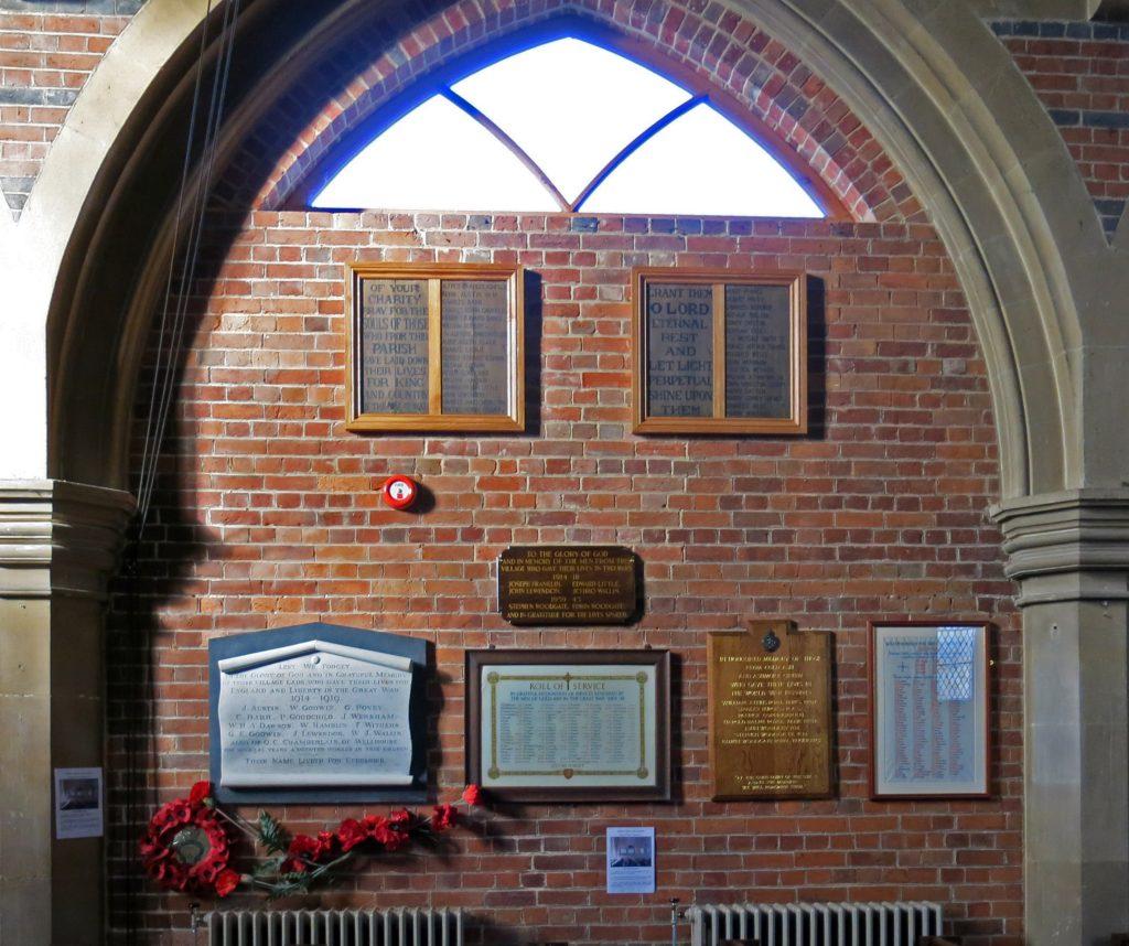 Parish memorials inside St Mark's Church on a designated 'Memorial Wall'.