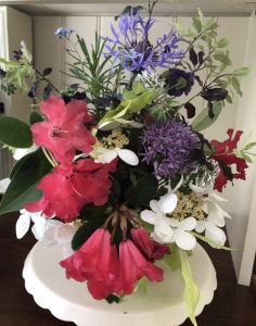 A flower arrangement on a round table.